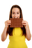 Girl holding chocolate bar Stock Image