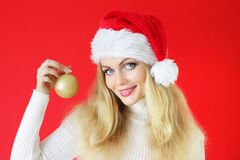 Girl holding a Christmas ball Stock Image