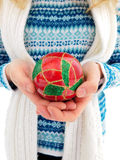 A girl holding Christmas ball in the hands. Winter photo. A girl holding Christmas red ball in the hands royalty free stock photo
