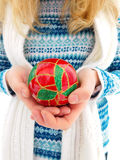 A girl holding Christmas ball in the hands. Winter photo. A girl holding Christmas red ball in the hands royalty free stock photography
