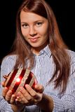 Girl holding christmas bauble Royalty Free Stock Photography