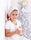 Girl holding Christmas bell Stock Images
