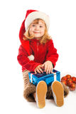 Girl holding Christmas gift Stock Images