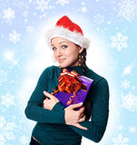 Girl  holding a Christmas gift Stock Images