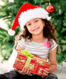 Girl holding a Christmas gift Royalty Free Stock Photo