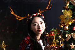 A girl holding a christmas gift box. Royalty Free Stock Image