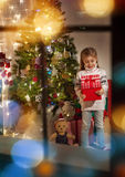 Girl holding Christmas gift Royalty Free Stock Images