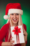 Girl holding Christmas gift Royalty Free Stock Image