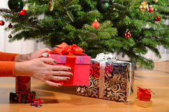 Girl holding a Christmas gift. In the hands Royalty Free Stock Photography