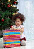 Girl holding Christmas gifts Stock Photo