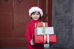 Girl Holding Christmas Gifts Stock Images