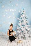 Girl holding Christmas gifts Stock Image