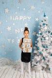 Girl holding Christmas gifts Stock Photos