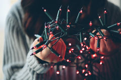 Girl holding a Christmas lamp garland Stock Images