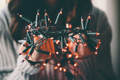 Girl holding a Christmas lamp garland Royalty Free Stock Photo