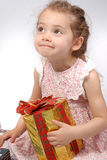 Girl holding a Christmas present Royalty Free Stock Images