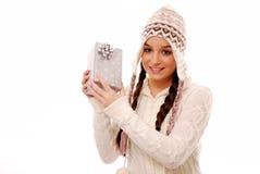 Girl holding christmas present Royalty Free Stock Image