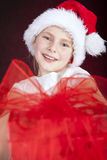 Girl holding christmas present. Smiling young girl holding christmas present Royalty Free Stock Image