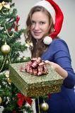 Girl holding a christmas present Royalty Free Stock Image