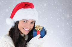 Girl Holding Christmas Present Near Face Stock Photography