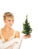 Girl holding a Christmas tree. Beautiful blond girl holding a Christmas tree isolated on white background Royalty Free Stock Image