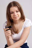 A girl holding a cigarette lighter. And looks at her Stock Photos