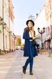 Girl holding city map on the European street Stock Image