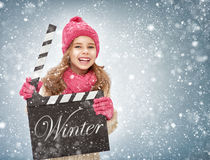 Girl holding clapper board Stock Photo