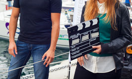 Girl holding clapperboard Stock Images