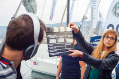 Girl holding clapperboard. TRIESTE, ITALY - OCTOBER, 12: Girl holding clapperboard during the production of short film on October 12, 2014 Royalty Free Stock Image