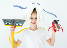 Girl holding cleaning supplies Stock Images