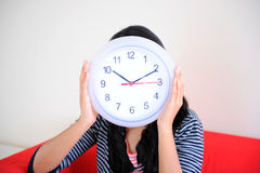 Girl holding clock. Girl holding a clock in her hands Stock Image