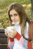 Girl holding coffee cup Stock Photography
