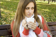 Girl holding coffee cup Royalty Free Stock Photography