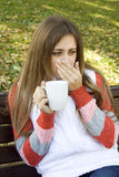 Girl holding coffee cup Royalty Free Stock Images