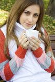 Girl holding coffee cup Royalty Free Stock Image