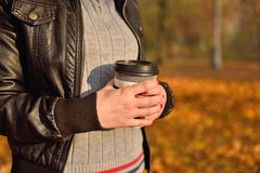 Girl holding coffee cup Stock Photos