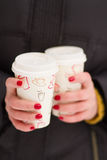 Girl holding coffee cups Royalty Free Stock Images