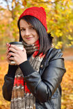 Girl holding coffee Royalty Free Stock Photography