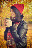 Girl holding coffee Stock Photography