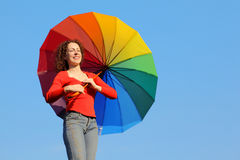 Girl holding colored umbrella Royalty Free Stock Photo