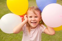 Girl holding colorful balloons Royalty Free Stock Photos