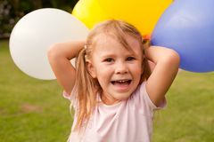 Girl Holding Colorful Balloons Royalty Free Stock Photography