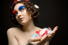 Girl holding colorful feathers Stock Image