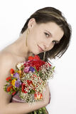 Girl holding colorful flowers Stock Photos