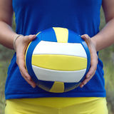 Girl holding a colorful sports ball for volleyball. Closeup Photo Stock Photography