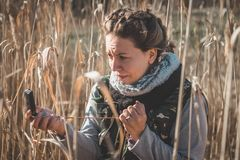 Girl is scared. She is lost in the wild. Girl holding a compass. Compass for better orientation in the nature. Girl is lost in the wild with compass. Girl is royalty free stock images