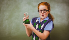 Girl holding conical flask in classroom Stock Photo