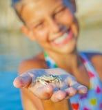 Girl holding crab Stock Photos