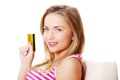 Girl holding credit card Stock Photos